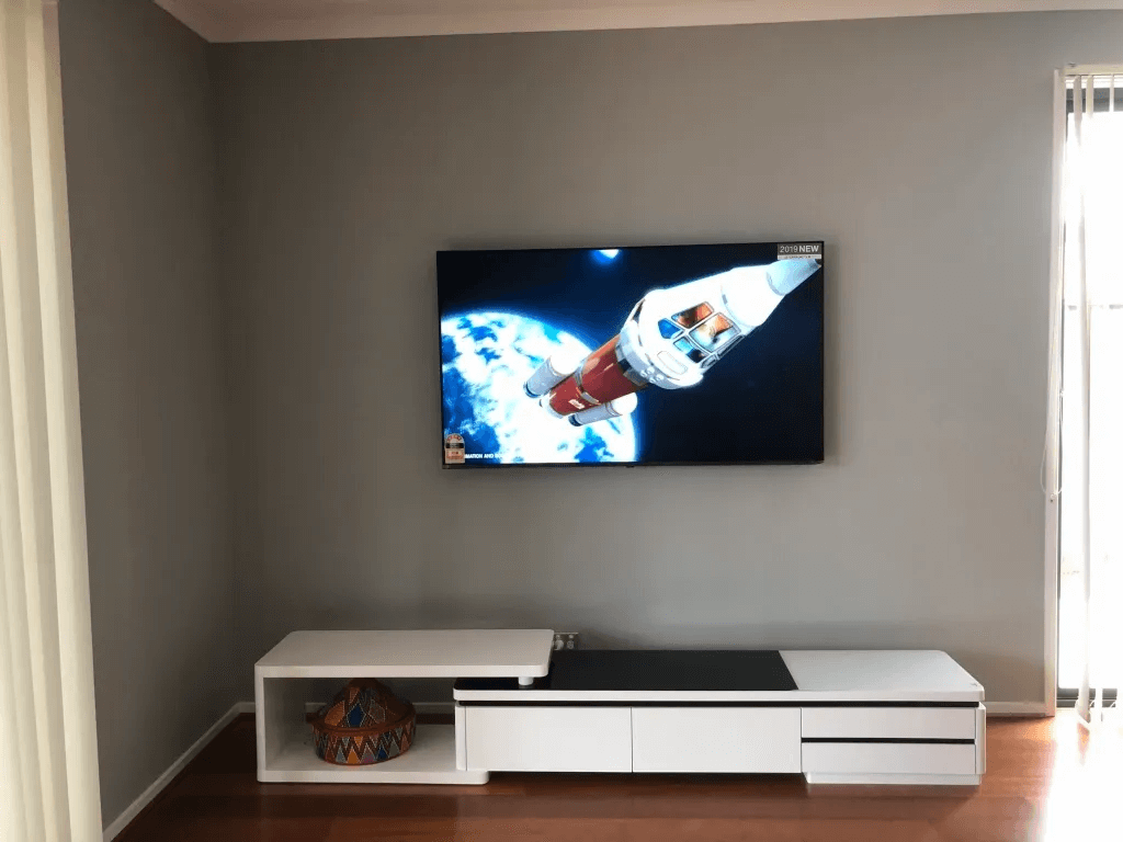 T&R Digital Antenna Installations - Gallery High Definition TV on the Wall Above Cabinet